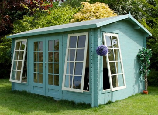 Luxury wooden garden rooms for Luxury garden sheds